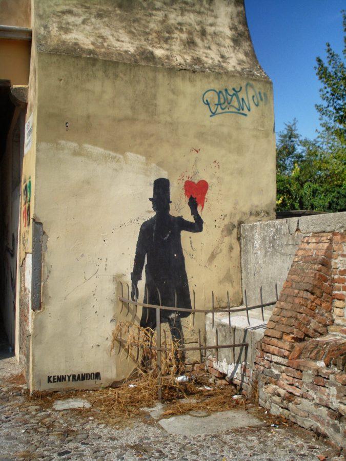 Graffiti om cu joben pe vidurile vechiului Padova, Italia
