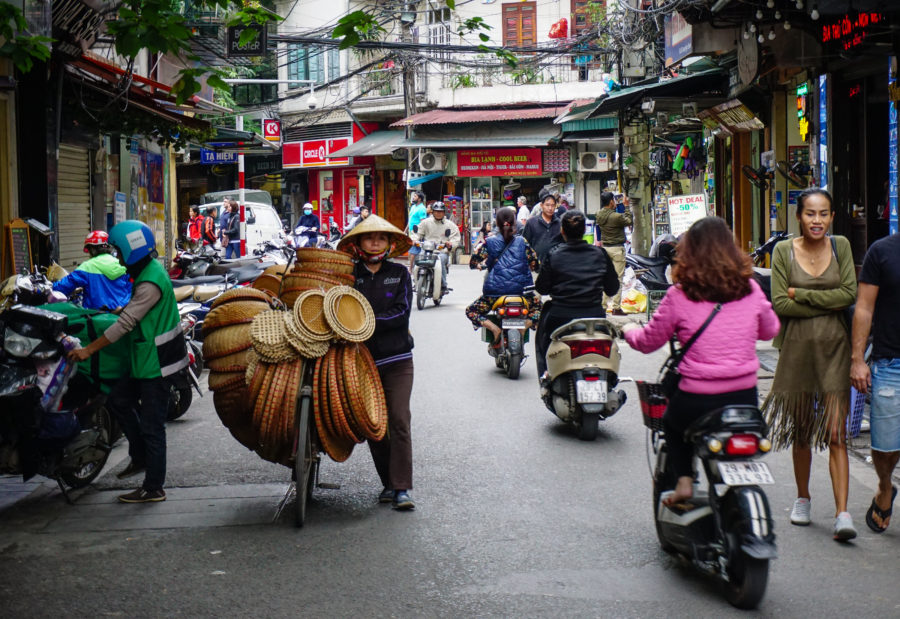 Selling hats in Hanoi, Vietnam