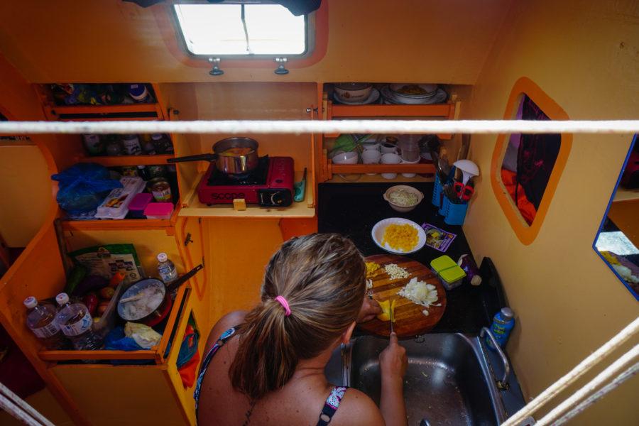 Boat interior, sofa and kitchen area